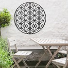 """Geometry """"Flower of Life"""" Steel Wall Art in Situ Outside Above a Wooden Table Set"""
