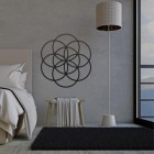 """Seed of Life"" Steel Wall Art in a Display in the Bedroom"