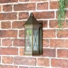 """Sandy Bay"" Brass Wall Lantern in Situ on a Garden Wall"
