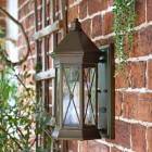 """Side View of the """"Sandy Bay"""" Wall Lantern Mounted Flush on a Brick Wall"""