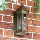 """Sandy Bay"" Brass Wall Lantern in Situ on a Brick Wall"