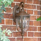 Traditional Top Fix Bronze Wall Lantern in Situ on a Brick Wall