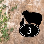 Sheep & Lamb Iron House Number Sign in Situ on a Rustic Wall