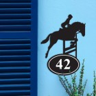 Showjumping Horse Iron House Number Sign in Situ on a Blue Wall