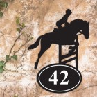 Showjumping Horse Iron House Number Sign in Situ on a Rustic Wall