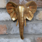 Gold Elephant Head Wall Art in Situ on a Brick Wall