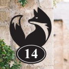 Simplistic Fox Iron House Number Sign on a Garden Wall