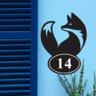 Simplistic Fox Iron House Number Sign in Situ on a Blue Wall