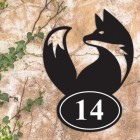 Simplistic Fox Iron House Number Sign in Situ a Rustic Wall