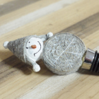Close-up of the Snowman Bottle Top