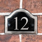 Vinyl Black & Chrome Arched Number Sign in situ on the Frpont of a House