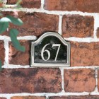 The Number 67 in Vinyl on the Arched Black & Chrome Number Plaque