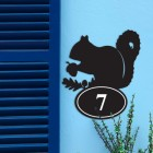 Squirrel Iron House Number Sign in Situ on a Blue Wall