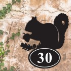 Squirrel Iron House Number Sign in Situ a Rustic Wall