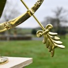 Close-up of the Polished Brass Fletch on the Arrow of the Serpent Armillary