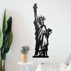 Statue of Liberty Wall Art on the Wall Next to Plants