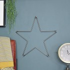 Steel Star Wall Art on a Blue Wall