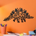 Geometric Iron Stegosaurus Wall Art on an Orange Wall