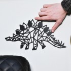 Geometric Stegosaurus Wall Art with hand for scale