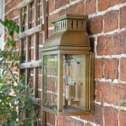 """Side View of the """"Stoneford Park"""" Half Wall Lantern Mounted on a Brick Wall"""