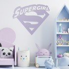 'Supergirl' Wall Art in a Children's Play Room Next to Toys