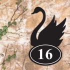 Swan Iron House Number Sign in Situ on a Rustic Wall