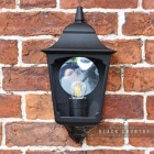 """Front View of the """"Tattershall Thorpe"""" Black Half Wall Lantern on a Brick Wall"""