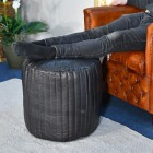 """""""The Coll"""" Black Leather Round Pouffe in Use in the Sitting Room"""