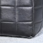 Close-up of the Black Leather on the Pouffe