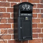 King George Post Box in Situ on a Brick Wall