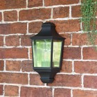 """Front View of the """"Traditional Black Flush Half Wall Lantern on a Brick Wall"""