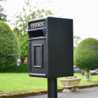 View of the Side of the Traditional Black & Gold Post Box and Stand