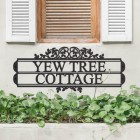 Traditional Foliage House Name Sign in Situ Underneath a Window