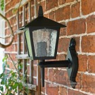 Traditional Bottom Fix Black Wall Lantern Installed On Brick Wall