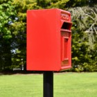 View of the Side of the Traditional Red & Gold Post Box and Stand