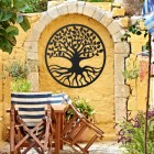 "Black Round ""Tree of Life"" Wall Art in the Garden"