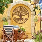 "Rustic Round ""Tree of Life"" Wall Art in the Garden"