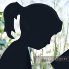 Close-up of the Face of the Girl Reading Silhouette