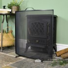 Black Curved Custom Fire Screen in Situ Next to the Fire Place
