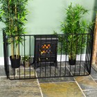 Simplistic Wrought Iron Nursery Fire Guard in Situ by the Fire Place
