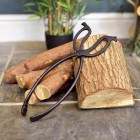 Traditional Iron Log Tongs on Fireside Logs