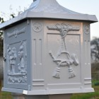 Side view of post box with decorative detailing