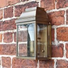 Flush fit wall lantern finished in antique brass