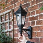 Traditionally designed wall lantern mounted to wall