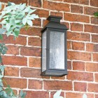 Traditional Aged Copper Wall Lantern on Brick Wall