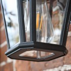 Close up of bulb and detailing on wall lantern