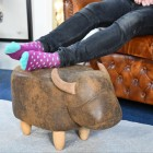 Biscuit the Brown Cow Foot Stool in use