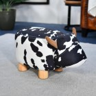 Daisy the Black & White Cow in Living Room Setting