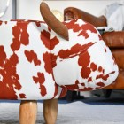 Side view of Brown & White Cow Foot Stool