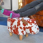 Buttercup the Brown & White Cow Foot stool in use